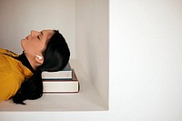 Young woman asleep on her books