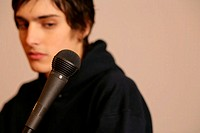 Young man with microphone (thumbnail)