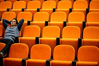 Young man alone in lecture theatre