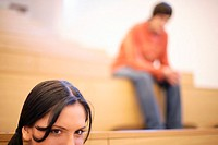 Young woman and man in lecture theatre