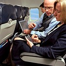Business people working in an aeroplane