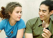 Young couple eating ice cream