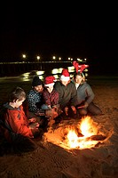 Family portrait and campfire on beach, Oak Island, North Carolina, USA