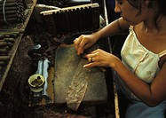 Cuba, Havana, woman making cigar