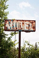 A rusty sign outside an abandoned motel , Ontario, Canada