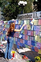 A woman visiting a September 11th memorial in Union Square, New York.