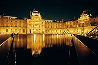 Grand Louvre art museum and Cour Napoleon by night, Paris. France