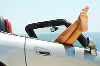 Woman lying down in sports car. Javea, Alicante. Spain