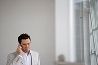 sad looking businessman with cellphone