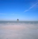 1 Canada Square in fog. A temperature inversion (increase in temperature with height) has caused moist cool air to become trapped in a layer over the ...