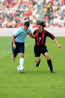 Soccer players battling for ball
