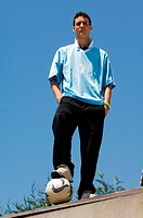 Teenage boys with foot on ball (thumbnail)