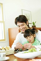 Girl And Father Eating Fruit