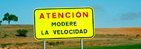 Traffic sign 'Modere la velocidad'. Road. Cuenca. Spain