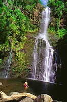 Hawaii, Maui, Pi´lani Highway, Woman swimming at Wailua Falls.