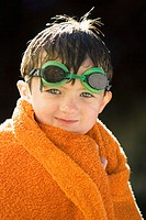 Five-year old boy with swimming googles looking at camera. Boise, Idaho USA