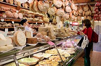 Hams and cheeses in food shop near Piazza Maggiore, Bologna. Emilia-Romagna, Italy