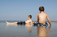 Boys Relaxing at Beach. Cape Cod, Massachusetts. USA