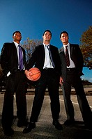 Businessmen on basketball court