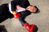 Businessman unconscious on floor