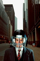 Businessman wearing an american football helmet