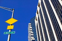 Road signs and buildings on Wall Street (thumbnail)