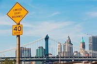 Road sign and Manhattan skyline