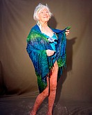 A mature woman wrapped in a sarong