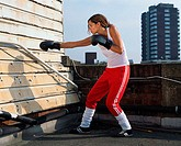 Female boxer on roof
