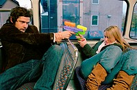 Couple with water pistols