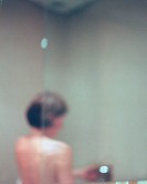 Woman showering (thumbnail)