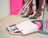 Handbag on beauty salon floor