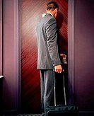 Man opening hotel room door