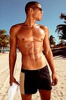 Muscular man on beach