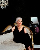 Senior woman on chaise longue