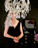 Senior woman behind chandelier