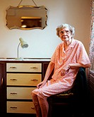Elderly woman in her room