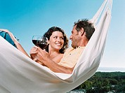 Couple in a hammock with wine