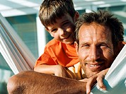 Father and son on hammock