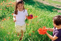 Girls picking wildflowers