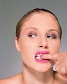 Woman rubbing her teeth