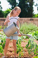 Girl watering plants