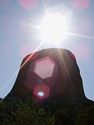 Devils Tower with lens flare, Wyoming, USA