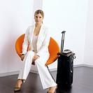 portrait of businesswoman in orange lounge chair
