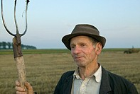 Farmer with pitchfork, Moldavia, Romania