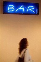 Bar sign and woman