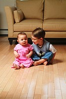 Brother and sister on livingroom floor