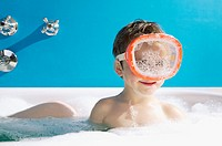 Boy wears a swim mask in the bathtub