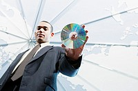 Low angle view of businessman holding disc