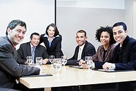 Group portrait of businesspeople at meeting